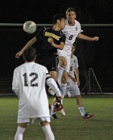 Senior Jake Hexberg goes up for the header during Laguna's 2-0 loss at home on Friday, Feb. 7.