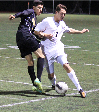 Sophomore Willy Wheeler dribbles past a Godinez defender during Laguna's 2-0 loss at home on Friday, Feb. 7