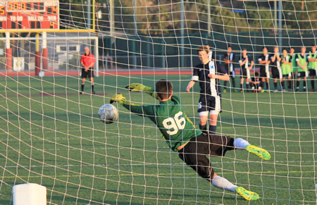 Goalie Dante Amodeo makes a key stop to seal Laguna's first round CIF win at home in a shoot out against Crossroads of Santa Monica.