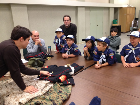 : Ex-marine Mike Ryan brings in his military uniforms to kids who also suit up for meetings.
