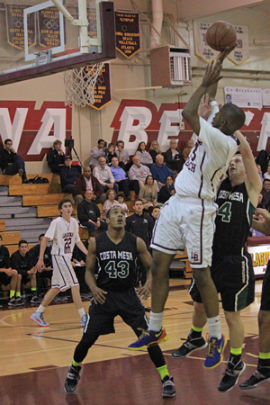 Senior Josh Adams works inside for two of his 19 points in Laguna's 81-53 home win on Wednesday, Jan. 29.