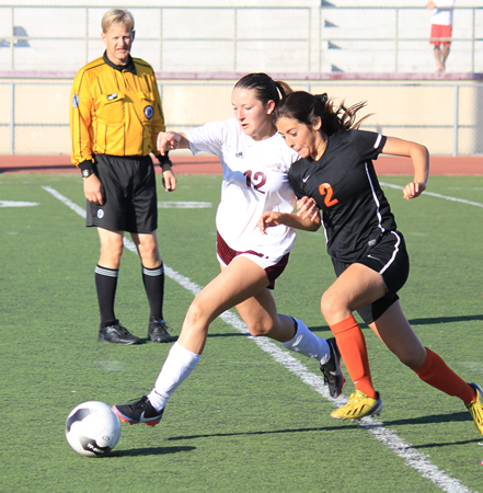 : Katelyn Carballo drives past a Chaffey defender in Laguna's 2-0 win against Ontario's Chaffey High on Friday, Feb. 21.