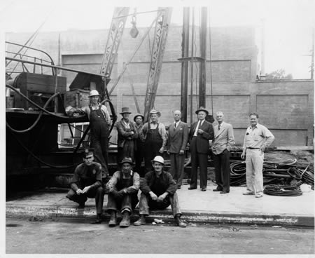 Al Stricker, far right, helped in the construction of Laguna Federal's Spanish style building, completed in 1946. The rear of the theater is visible behind the workers. Photos courtesy Amos Stricker