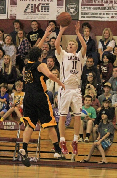 Alec Wulff hits spark a second half surge to lead Laguna to a 67-55 win this past Friday, Feb. 21. Photo by Todd Miller