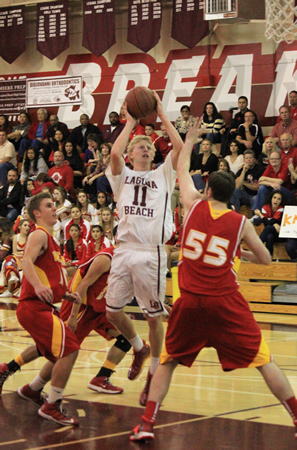 Alec Wulff collects two of his game high 26 against Whittier Christian. Photo Credit: Robert Campbell