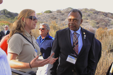 Environmental science intern Nora Papian describes the quick return of endangered gnatcatchers after construction ended at Crystal Cove State Park to the department's director, Anthony Jackson. Photo by Andrea adelson