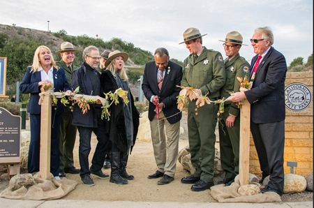 State Parks Director Anthony Jackson, center, officially opens the Berns Environmental Study Loop in Crystal Cove State Park this past Friday, Jan. 31, which also marks the department's 150th anniversary. To his left, Crystal Cove Alliance founder Laura Davick, Michael and Tricia Berns; to his right, Parks Superintendent Todd Lewis, District Superintendent Richard Rozzelle, and Crystal Cove Alliance chair Bill Baker. Photo by J. Christopher Launi