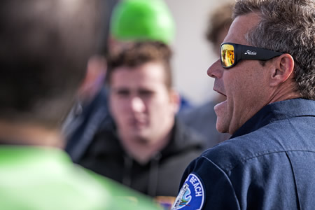 Department of Marine Safety Lt. Scott Diederich instructs participants on the ground rules for the three academy qualifying events.