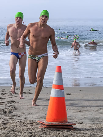 : Participants round a cone to finish the third leg of the run-swim-run event.
