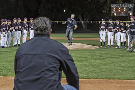 Hobie's owner Mark Christy throws the ceremonial first pitch to Angels President John Carpino as teams from VFW and Rotary celebrate opening day at the newly refurbished Riddle Field on Monday. Photo by Mitch Ridder