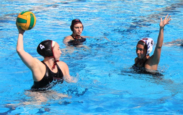 Photo by Robert Campbell    Harvard sophomore Yoshi Andersen, left, guarded by her freshman teammate Lexie Del Toro during an inter-squad practice at Laguna Beach High. The two Breaker alums were in town with their college teammates on a weeklong 10-game west coast road trip.