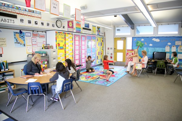 Teacher aid Jennifer Carlson and teacher Elizabeth Harris at El Morro, where even classroom configuration is evolving to reflect a new approach to instruction. Photo by Jody Tiongco