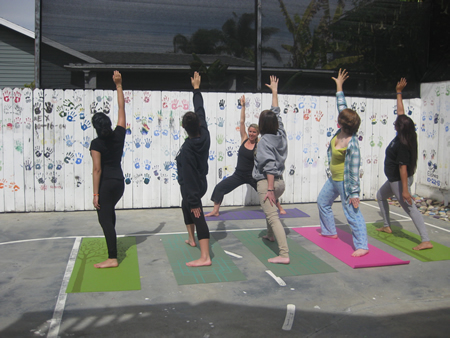 Photo courtesy CSP Youth Shelter Youth Shelter staff member Niki Smart leads residents in a yoga class.