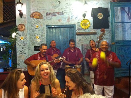 Carla Tesak Arzente, left, Carla Arzente, Niki Rushin and Olga Suttner on an art education trip to Cuban, entertained at Havana's La Bodeguita