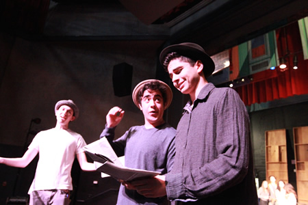 "Photo by Roark Gourley. From left, Noah Pattillo with Tristan Cham and Tony Davia rehearsing in ""Guys and Dolls,"" which opens Friday, March 14 at the Artists' Theatre."