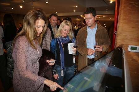 Visitors use multi- touch screens