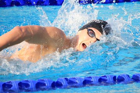 Junior Erik Juliusson won the 200 free during a home meet against Pacific and Garden Grove, Wednesday, March 5. Photo Credit: Robert Campbell
