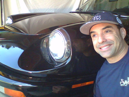 Reed with his car.