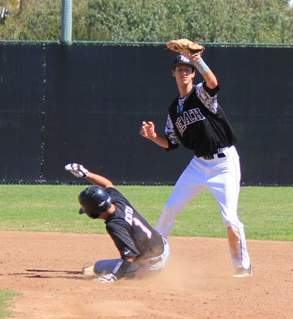 Senior shortstop Preston GrandPre makes the out at second during Laguna's 28-0 win at home against Troy, Saturday, March 8.