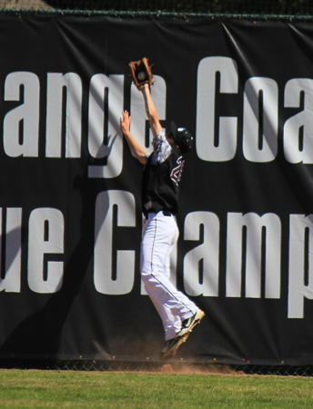Senior Grant Wilhelm makes the catch up against the fence during Laguna's 28-0 win at home against Troy, Saturday, March. 8.