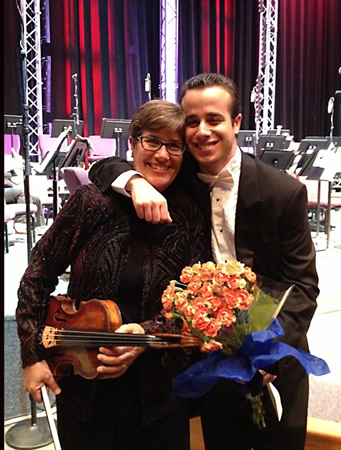 Photo by Adrienne Helitzer  Leonie Kramer and her son Isaac, of Laguna Beach, celebrate after their performances in South Coast Symphony last Friday; he conducted Mozart's piano Concerto 23 and she played viola.