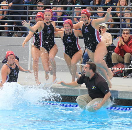 The girls' water polo team celebrates their Division 1 win with a splash. Photo by Bob Campbell