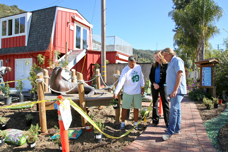 Board Member Ruben Flores, Melissa Siacca and Keith Matassa work on the new landscaping.