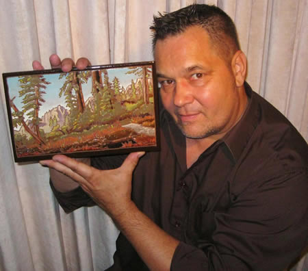 Laguna artist Mike Tauber and one his tile paintings on display at John Wayne Airport through April.