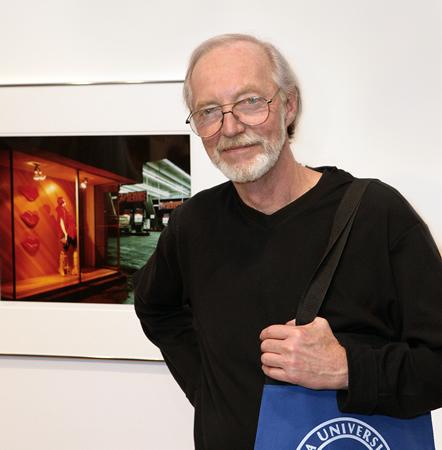 Mark Chamberlain at a recent Soka University exhibition of his work.
