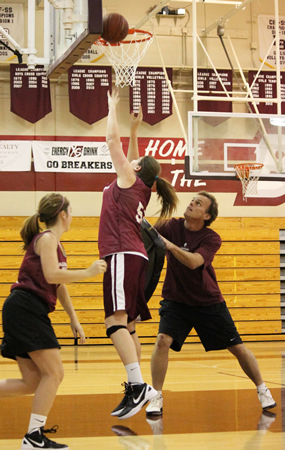 Coach Mark Lewis runs drills with Jane Wallin during his first season as girls basketball coach in 2011.