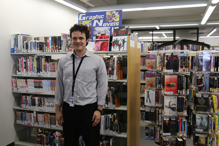 Manager Jon Gilliom, a self-confessed comic book fan, amid the graphic novel section he started at the Laguna branch library. Photo by Charlie Craig