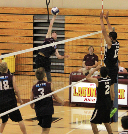 Outside hitter Jake Hexberg goes for the kill against Costa Mesa in a league match at Dugger Gym on Tuesday, April 8.