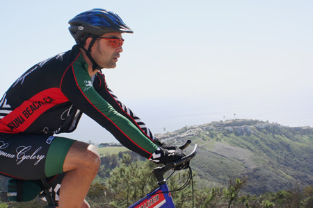 The author riding in the Alta Laguna Park area with Mystic Hills in the background.