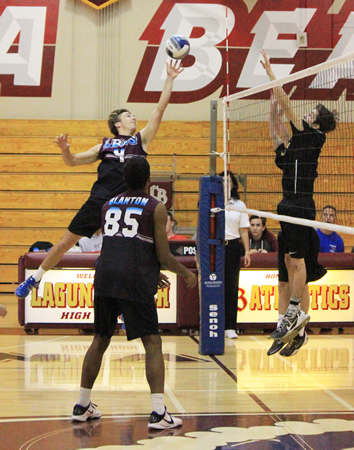 Senior outside hitter Troy Thomas goes for the lob kill against the Estancia defense in a league match at Dugger Gym on Tuesday, April 1.