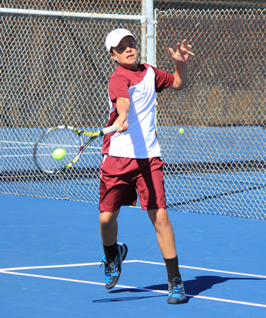 Laguna's top singles player Zack Washer hits a forehand during a league win against Costa Mesa on the Breaker's home courts Tuesday, April 1