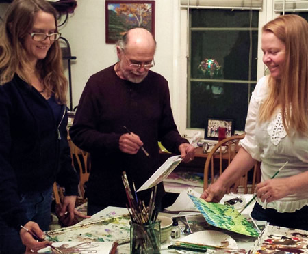 From left, April, David and Gaylen Solomon plan an art show together.
