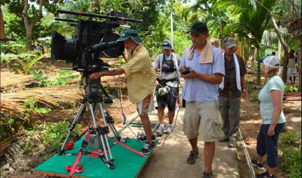"A cameraman on location shooting for ""Journey to the South Pacific"""