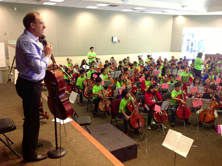 Ian McKinnell contributes to music education as part of the Class Act program, seen here in an Irvine school.