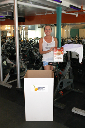 Shelley Arends-Cornwell in her Rhythm Ride spin studio, collecting donations for the Laguna Food Pantry.