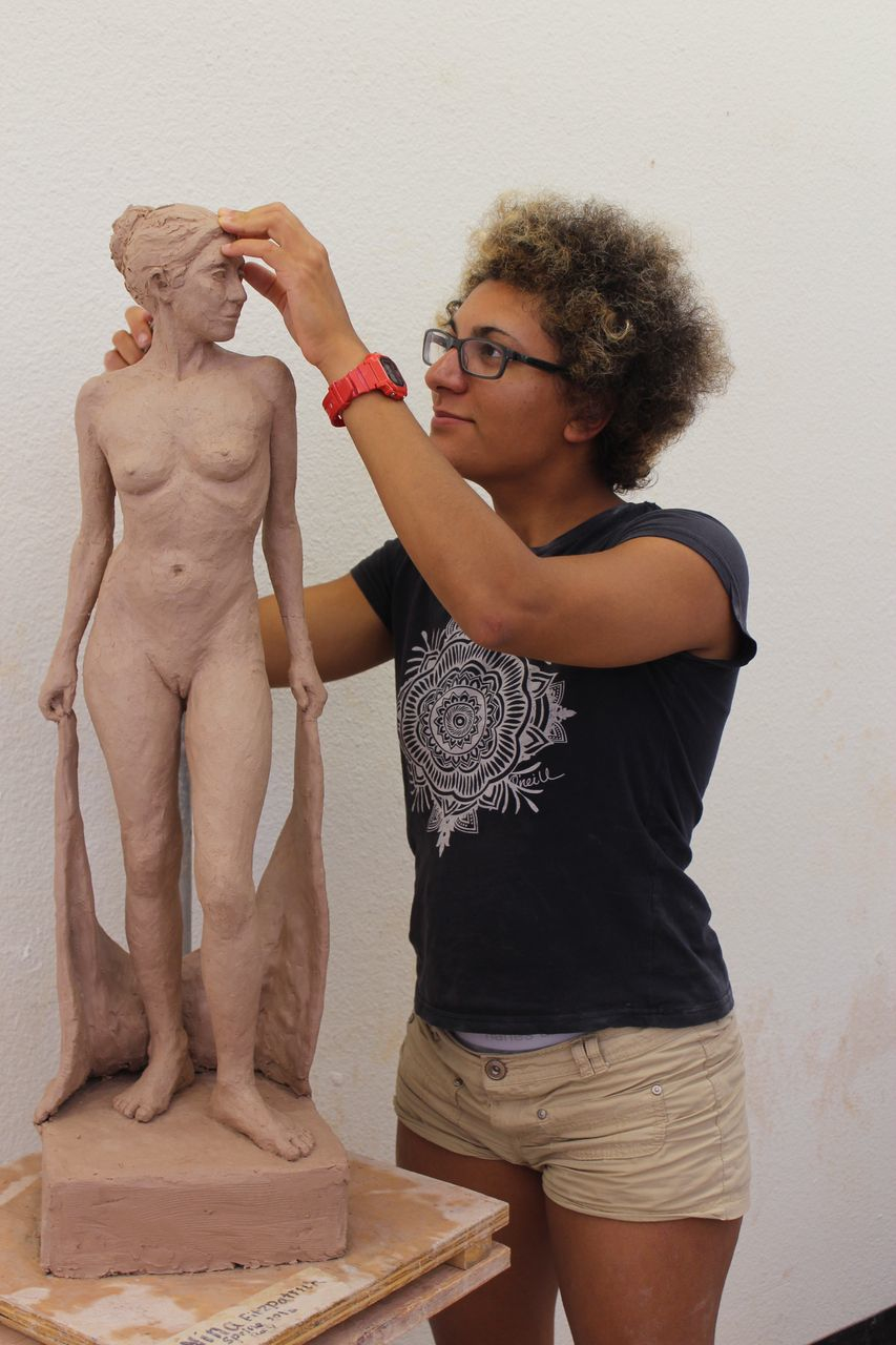 Art student Nina Fitzpatrick at work on sculpture. She died this week as a result of a traffic collision near campus.