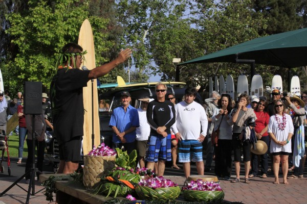 Kawika Carvalho, of Kaui, carrying a hookupu containing water, salt and earth from Oahu for dispersal during the paddle out ceremony. Photo by Andrea Adelson.