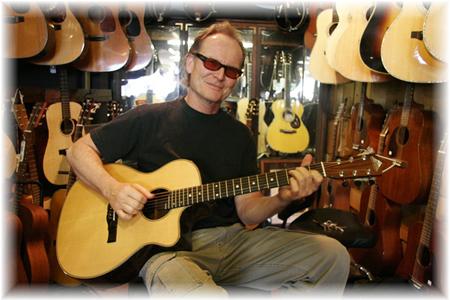 Bob Hawkins among his element at The Guitar Shoppe in north Laguna Beach.