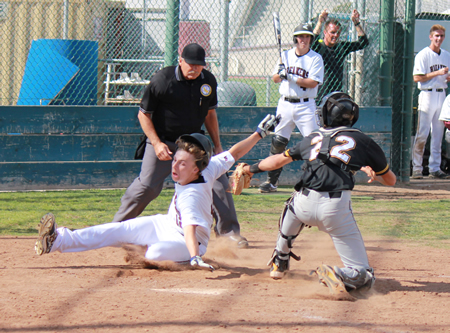 Callan Cochran appears to avoid the tag at home but the umpire called him out to end a second inning Breaker rally at home against Godinez on Tuesday, May 6.