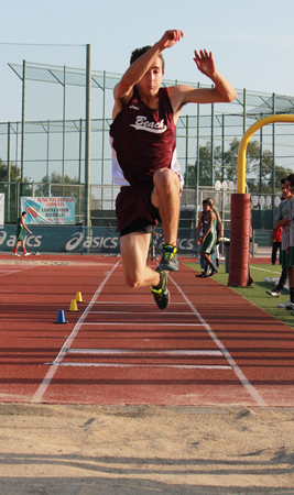 "Mike Santana sailed into the record books with a leap of 43'9"" in the triple jump to take the league title. Photo Credit: Robert Campbell"