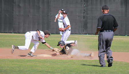 Shortstop Preston GrandPre tags out a Godinez runner attempting to steal second, ending the inning and a Grizzlies rally at two runs. Photo by Robert campbell