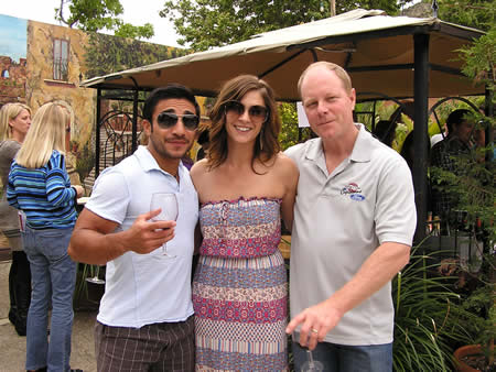 Brandon Menchaca, left, with sponsors Emily France and David Sanford.