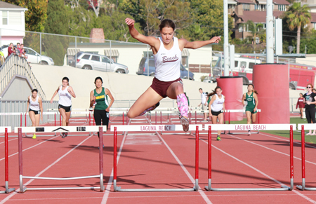Coco Putnam blows the field away in the 300 hurdles on her home track at Orange Coast league finals, Thursday, May 8.