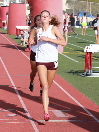 :  Coco Putnam coasts to an easy win in the 400 on her home track at Orange Coast league finals, Thursday, May 8.