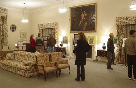 The church parlor serves as a gallery for a  First Thursday display.