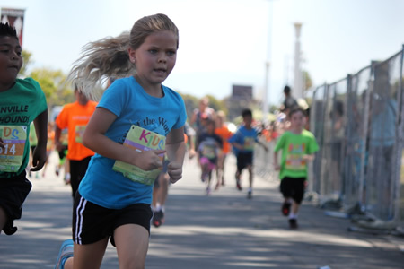 Second-grade TOW student Presley Jones in mid-run.